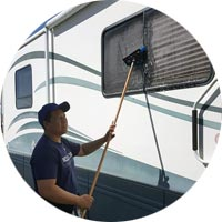 Suns Auto Detailing cleaning exterior of RV